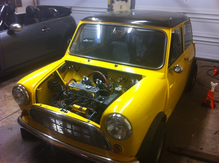 1960 Mini 850 in foreground; 2009 MINI Cooper S in background