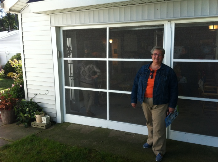 Sharon by the garage - her father made the doors in the mid 1950's.