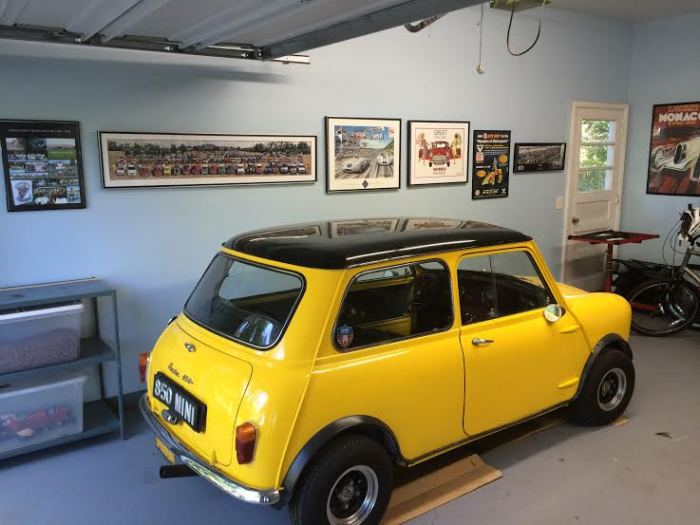 Mini in front of art wall...