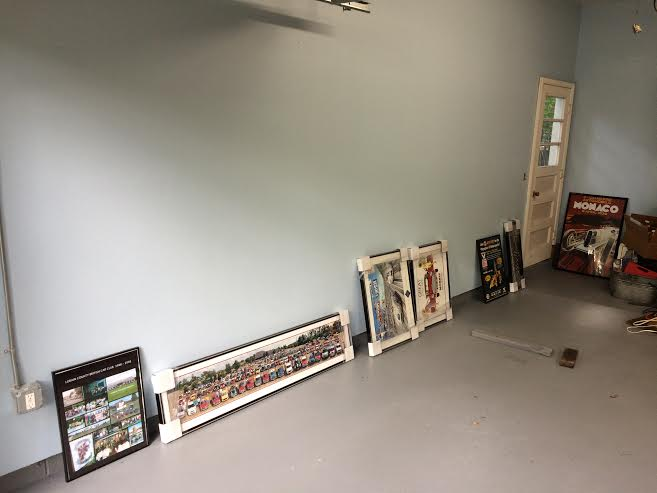 I carried the pictures to be hung on the gallery wall up to the garage.